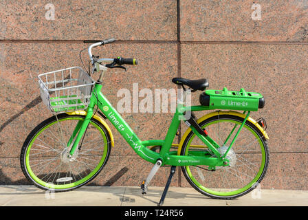 A Lime-e electric-assist bike in London, UK - Stock Image