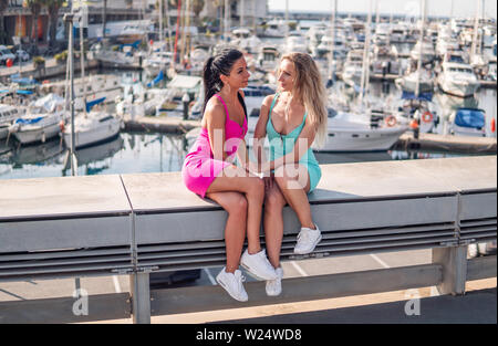 Happy best friends or sisters posing and showing lovely relationship - Stock Image