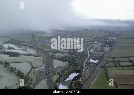 Aeial photograph of of a snow shower drifiting over the English countryside - Stock Image
