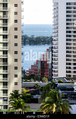 Key Biscayne causeway and bay waters can be seen between high-rise residential towers of downtown Brickell in Miami, - Stock Image