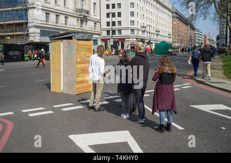 Queing for the 'Doctor Loo' portable makeshift toilet at the Extinction Rebellion demonstration in Marble Arch - Stock Image
