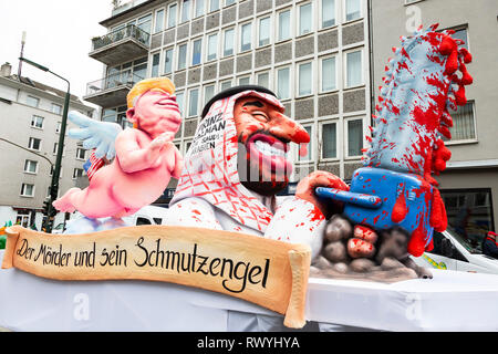 Düsseldorf, Germany. 4 March 2019. The annual Rosenmontag (Rose Monday or Shrove Monday) carnival parade takes place in Düsseldorf. Donald Trump watching over Mohammed bin Salman, crown prince of Saudi Arabia who is wielding a chain saw. Carnival float designed by German artist Jacques Tilly. - Stock Image