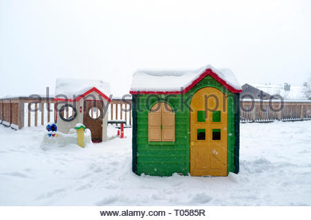 Two plastic Wendy houses, in the snow, in France. - Stock Image