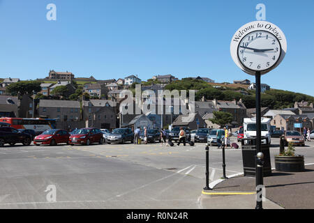 Visitors in the car park area by the pier and harbour in Stromness, Orkney, Scotland - Stock Image
