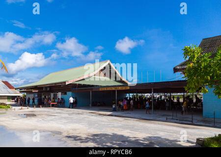 South Tarawa, Kiribati - Jan 8 2015: Passengers waiting for a flight at the terminal of Bonriki International Airport. Air travel in Republic of Kirib - Stock Image