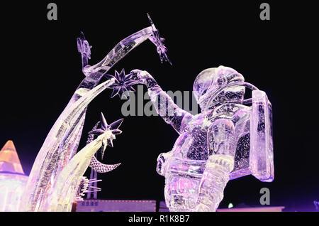 Astronaut ice sculpture in Harbin Ice & Snow World Festival 2018 - Stock Image
