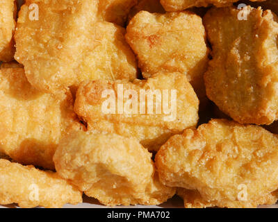 A close up of chicken McNuggerts - Stock Image