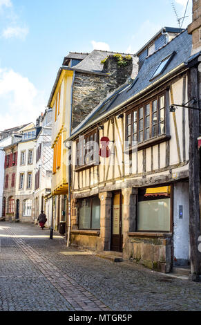 Along an almost silent street on the upper levels of Morlaix, the violin maker's shop is now closed and the blinds are drawn down. - Stock Image