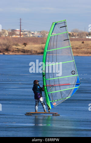 Littleton, CO - An ice sailor navigating across Chatfield Reservoir on the frozen ice. - Stock Image