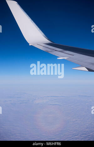 airplane's wing in the air - Stock Image