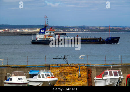 PD Teesport Suction Dredger Heortnesse passing the South Gare on its way to dump soil offshore - Stock Image