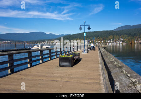 Pier at Rocky Point Park in Port Moody, BC, Canada. Port Moody, British Columbia. Waters of Burrard Inlet. - Stock Image