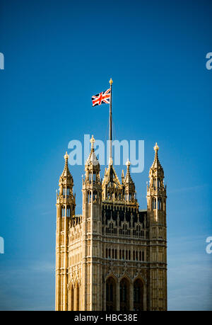 Victoria Tower, part of the Palace of Westminster, with a Union Jack on the flag pole. - Stock Image