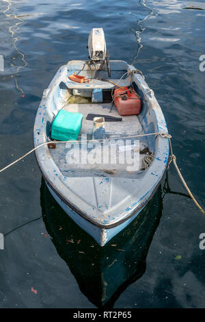small GRP boat with outboard engine moored in Malta - Stock Image