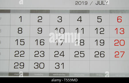 Calendar July 2019 with working days and weekends, close-up top view. - Stock Image