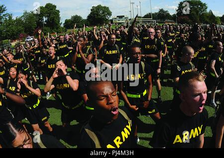 Soldiers cheer on their units during the 23rd Quartermaster Brigade Drill and Ceremony Competition Aug. 23 at Fort Lee. - Stock Image