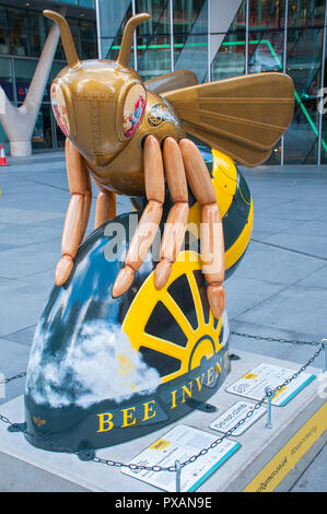 Rocket, the Steam (punk) Bee, by Sinclair Illustration.  One of the Bee in the City sculptures, Spinningfields Square, Manchester, UK. - Stock Image