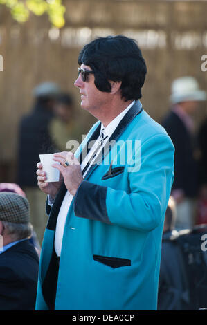 Chichester, West Sussex, UK. 14th Sep, 2013. Goodwood Revival. Goodwood Racing Circuit, West Sussex - Saturday 14th September. Elvis look-a-like holds a cup of coffee in the cafe area of the circuit. Credit:  MeonStock/Alamy Live News - Stock Image
