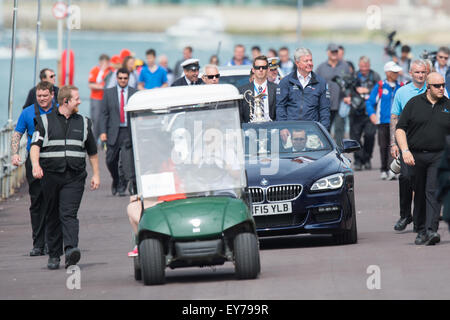 Portsmouth, UK. 23rd July 2015. Sir Keith Mills escorts the America's Cup alongside the fanzone ready for it's - Stock Image