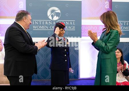 U.S First Lady Melania Trump, right, and Secretary of State Mike Pompeo, left, present Colonel Khalida Khalaf Hanna al-Twal of Jordan with the 2019 International Women of Courage awards at the State Department March 7, 2019 in Washington, DC. - Stock Image