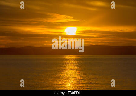 Newlyn, Cornwall, UK. 5th Apr, 2019. UK Weather. A cold but calm and colourful start to the morning at Newlyn looking out to Mounts Bay. Credit: Simon Maycock/Alamy Live News - Stock Image