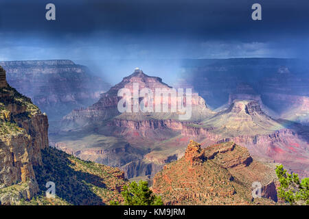 Rain over the Grand Canyon formations with ever changing light - Stock Image
