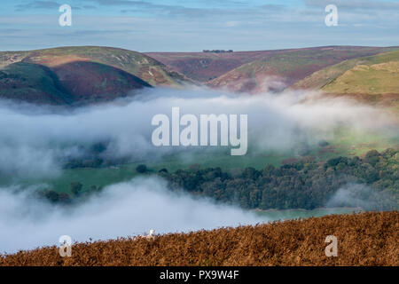 Mist in one of the Long Mynd's valleys, seen from Ragleth Hill, Church Stretton, Shropshire - Stock Image