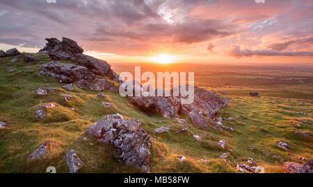 Vivid sunset on Sourton Tor Dartmoor national park Devon Uk - Stock Image