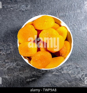 Bowl of Healthy Soft Apricots In A White Bowl Shot From Above with No People - Stock Image