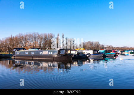River Nene at White Mills Marina on a sunny clear day with plenty of narrowboats moored in the marina. - Stock Image