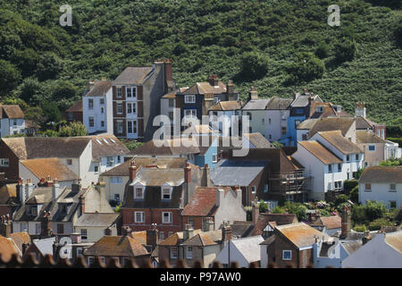 Hastings, UK -July 14 2018: General view of the seaside town of the fishing port of Hastings on a hot summers day as the temperatures sore to above 27 degrees on 14 July 2018.  Hastings on the south coast of England is 53 miles south-east of London and is 8 miles from where the  Battle of Hastings took place in October 1066. Credit: David Mbiyu Credit: david mbiyu/Alamy Live News - Stock Image