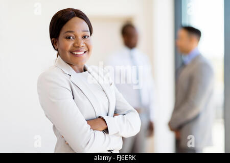 pretty African female corporate worker in office - Stock Image