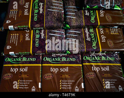 A stack of bags of Levington Organic Blend Top Soil in a garden centre - Stock Image