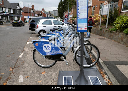 A row of nextbikes German nextbike scheme bikes bicycles parked at a rental station in the street in Llanishen village Cardiff Wales UK  KATHY DEWITT - Stock Image