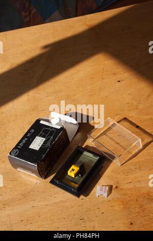 Moody lighting of a Linn K9 record cartridge - Stock Image