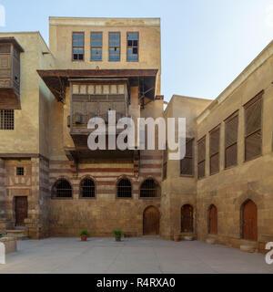 Facade of Zeinab Khatoun historic house, located near to Al-Azhar Mosque in Darb Al-Ahmar district, Old Cairo, Egypt - Stock Image