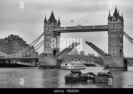 Tower Bridge in London opening up for passing boats - Stock Image