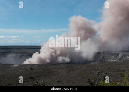 Hawaii, USA 12th May 2018. A grey ash plume rises from the Kilauea volcano May 11, 2018 in Hawaii. The recent eruption continues destroying homes, forcing evacuations and spewing lava and poison gas on the Big Island of Hawaii. Credit: Planetpix/Alamy Live News - Stock Image