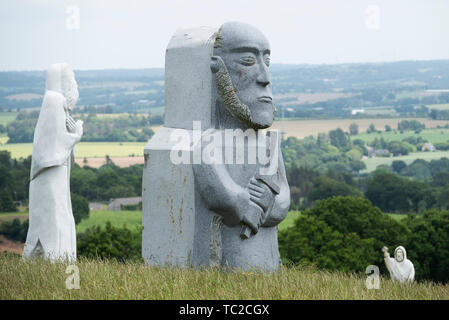 St Luner granite sculpture in the Valley of the Saints, Quenequillec, Brittany, France. - Stock Image
