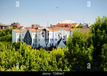 Graffiti and Paintings on House Buildings Near Puente de Toledo in Madrid - Stock Image