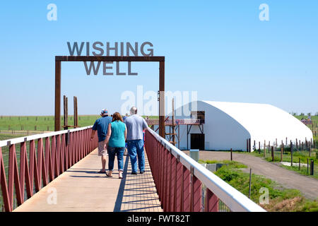 Visitors walk along the viewing area over various animal habitats at The Wild Animal Sanctuary. - Stock Image