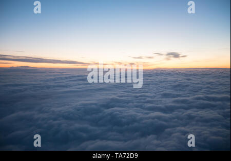 View from plane window - blue sky with white clouds, wide angle - Stock Image