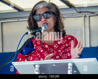 London, UK. 12th May 2019. Leading international climate lawyer and diplomat Farhana Yamin, arrested recently protesting with XR at Shell's London HQ,  speaks at the rally filling Parliament Square at the end of the XR International Mothers' Day March.  She says she decided to get arrested as she now realises that far more urgent and drastic action is needed to avert climate disaster and we cannot continue 'business as usual'as it is destroying life on our planet. Peter Marshall/Alamy Live News - Stock Image