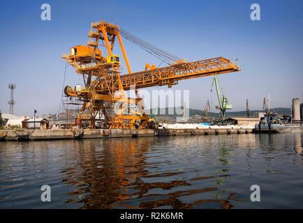 A shot of a yellow ship crane - Stock Image