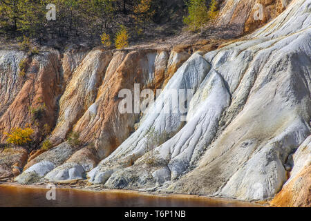 Black artificial lake and hills as a result of mining and production of copper in Bor, Serbia - Stock Image
