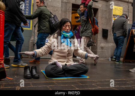 London, UK, 10 February, 2019. Chinese woman seen protesting against Chinese Government curbing people practicing the Ancient Tradition of Falun Gong during Chinese New year celebration at China Town, SOHO, London, UK. Alamy/Harishkumar Shah - Stock Image
