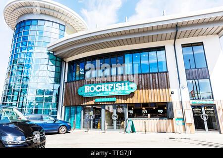 Rockfish seafood restaurant, Brixham, Devon, UK, England, United Kingdom, The Rockfish Brixham, New Fish market, Brixham, seafood restaurant, New fish - Stock Image