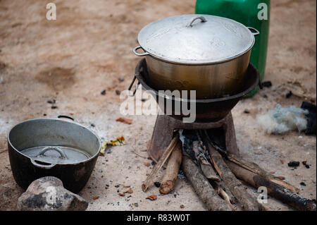 Mali, Africa. Metallic pots places on the dirty ground in a village near Bamako - Stock Image
