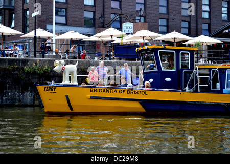 Statue of Gromit on the bow of Bristol Ferry, Brigantia of Bristol on Bristol's Floating Harbour, near SS Great - Stock Image
