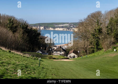 View across to Seaton from the South West Coastal path as it climbs up through Axe Cliff Golf Club at Axmouth, clubhouse in foreground. - Stock Image